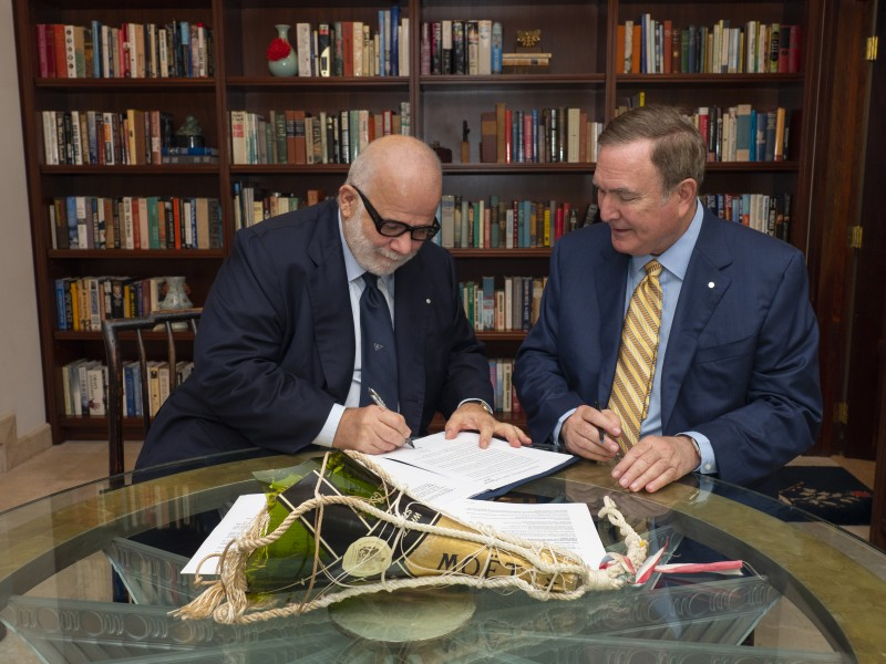 Silversea Cruises' Executive Chairman, Manfredi Lefebvre, and Royal Caribbean Cruises Ltd.'s Chairman and CEO, Richard D. Fain, ink RCL's investment in Silversea Cruises.